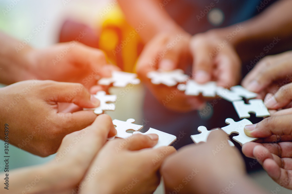 Fototapeta Team work, hands and jig Saw Unite with power Is a good team of successful people Team work concept