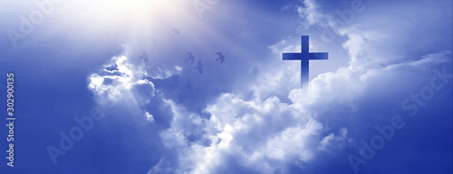 Obraz Christian cross appeared bright in the sky with soft fluffy clouds, white, beautiful colors. With the light shining as hope, love and freedom in the sky background - fototapety do salonu