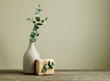canvas print picture - Eucalyptus branch in a vase on the rustic wooden table