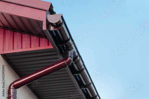 Fototapeta Plastic roof gutter and drain pipe with copy space obraz