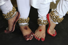 Two Pairs Of Legs In Kathak Pose