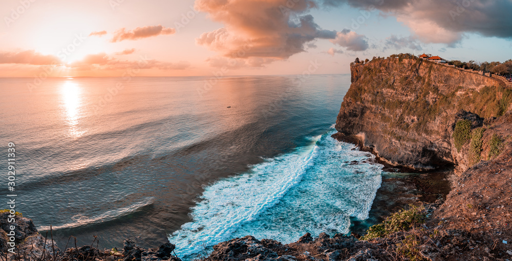 Fototapety, obrazy: Beautiful Panoramic view of an Iconic Famous Place, Uluwatu Temple, during a vibrant summer sunrise. Located in Bali, Indonesia