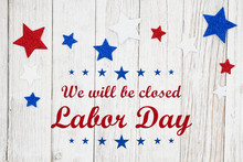 Closed Labor Day With Red, White And Blue Stars On A Weathered Whitewash