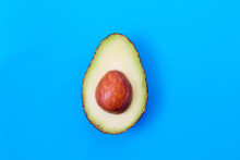 Open Natural Avocado Isolated On Color Background