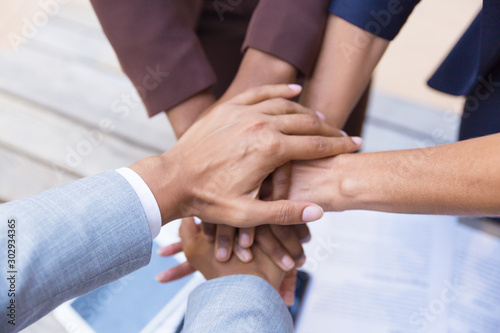 Business team putting their hands together, expressing unity, support, friendship Tablou Canvas
