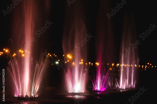 Ukraine. Kyiv - 05.06.2019 Amazing dancing fountain in the night illumination of rainbow color with colorful illuminations on the lake.
