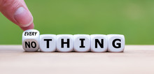 """Hand Turns A Dice And Changes The Word """"nothing"""" To """"everything""""."""