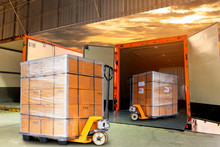The Truck Container Docking Load Shipment Goods Pallet, Hand Pallet Truck With Stacked Package Boxes On Pallet, Freight Industry Delivery Logistics And Transport.