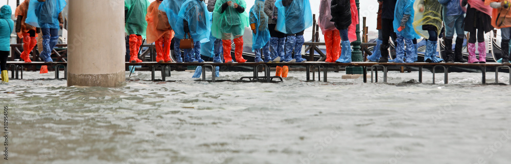 Fototapety, obrazy: footbridge on the water during the flood in Venice in Italy
