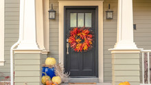 Panorama Frame Autumn Decorations And Colorful Wreath At Sunset