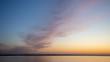 canvas print picture - Sonnenuntergang an der Nordseeküste über einem Windenergiepark in gold und blau