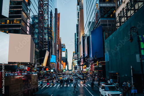 Photo sur Aluminium New York TAXI Times square view with blank billboards and copy space for advertising or commercial content on building facades, famous touristic place in New York with busy traffic and publicity area on streets .