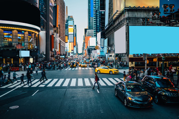 Famous Times Square landmark in New York downtown with mock up billboards for advertising and commercial information content. Big metropolis urban scene with development infrastructure with Lighboxes