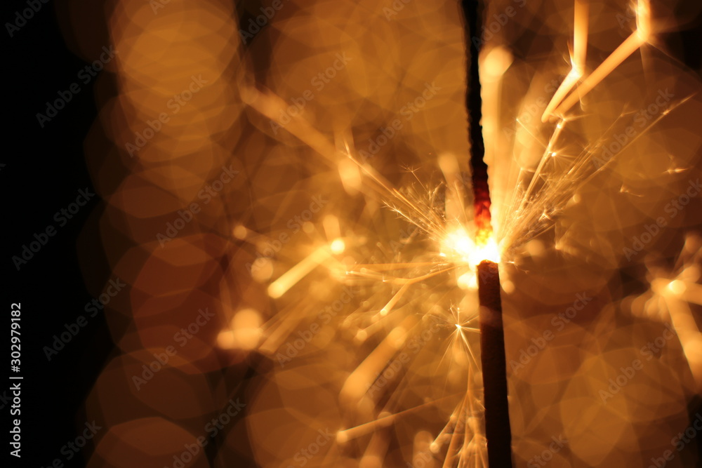 Fototapety, obrazy: Bengal fire and sparks macro photo festive bokeh background Christmas and New Year
