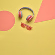 canvas print picture Minimal fashion, Trendy headphones. Music vibration on geometry background. Hipster DJ accessory Flat lay. Art creative summer vibes, fashionable pop art style. Sweet pastel design color