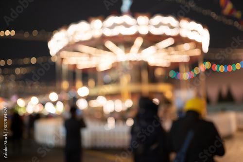Fototapeta  Carousel with burning lights , blurred photo.
