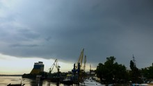 The Crane Works Before The Rain