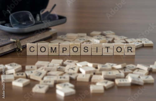 Cuadros en Lienzo  Compositor the word or concept represented by wooden letter tiles