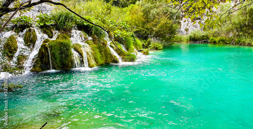 Wall Murals Green coral Waterfall in Plitivice national park, Croatia.