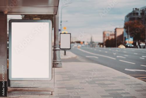 A city bus stop with an empty ad banner mock-up; template of advertising banner Billede på lærred