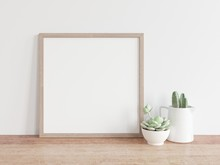 Square Wooden Frame Mock Up With Green Cactus. 3D Illustrations.