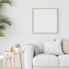 Square Wooden Frame Mock Up With Sofa And Green Plants On White Wall In Living Room. 3D Illustration.