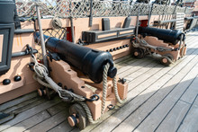 PORTSMOUTH, ENGLAND - 6 October 2019: Old Vintage Cannon Of HMS Victory The Historical Battleship Or Warship At Portsmouth Historic Dockyard.