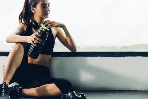 Foto op Canvas Ontspanning Happy asian beautiful woman lifestyle her sitting relaxation after workout training