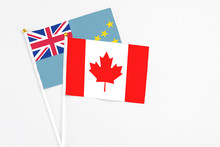 Canada And Tuvalu Stick Flags On White Background. High Quality Fabric, Miniature National Flag. Peaceful Global Concept.White Floor For Copy Space.
