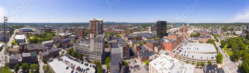 Manchester downtown building including City Hall Plaza and Brady Sullivan Plaza with Merrimack River at the background panorama aerial view, Manchester, New Hampshire, NH, USA Canvas Print