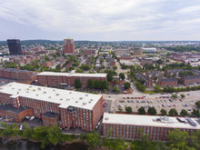 Manchester Downtown Building Including City Hall Plaza And Brady Sullivan Plaza With Merrimack River In The Front Aerial View, Manchester, New Hampshire, NH, USA.