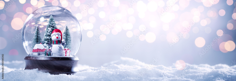 Fototapeta Snow globe on festive background