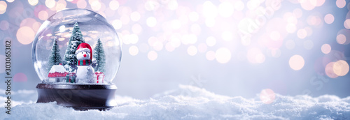 Canvas Prints Coffee bar Snow globe on festive background