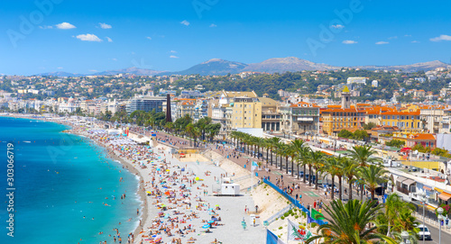 Promenade des Anglais in Nice, France. Nice is a popular Mediterranean tourist destination, attracting 4 million visitors each year #303066719