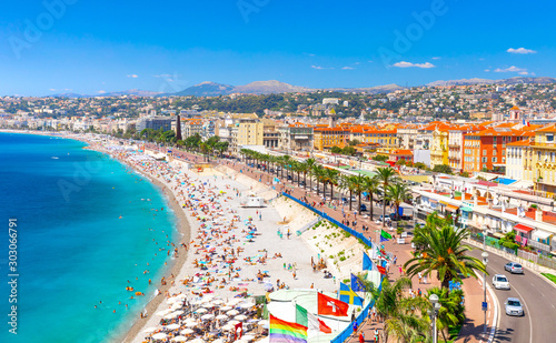 Promenade des Anglais in Nice, France. Nice is a popular Mediterranean tourist destination, attracting 4 million visitors each year - 303066791