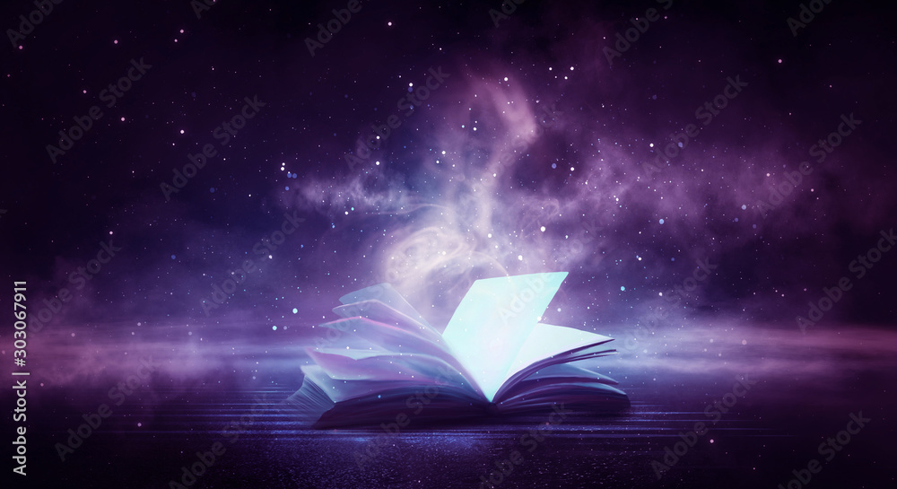 Fototapety, obrazy: An open book on a wooden table under the night sky against a dark forest. Magical radiance. Night scene.