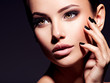 canvas print picture - Face of a beautiful girl with fashion makeup and black nails