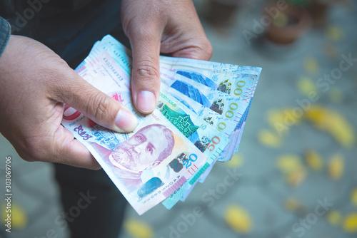 Fotomural  Hands holding georgian lari bills