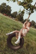 Happy Girl Swinging On A Wheel, Walk In Nature