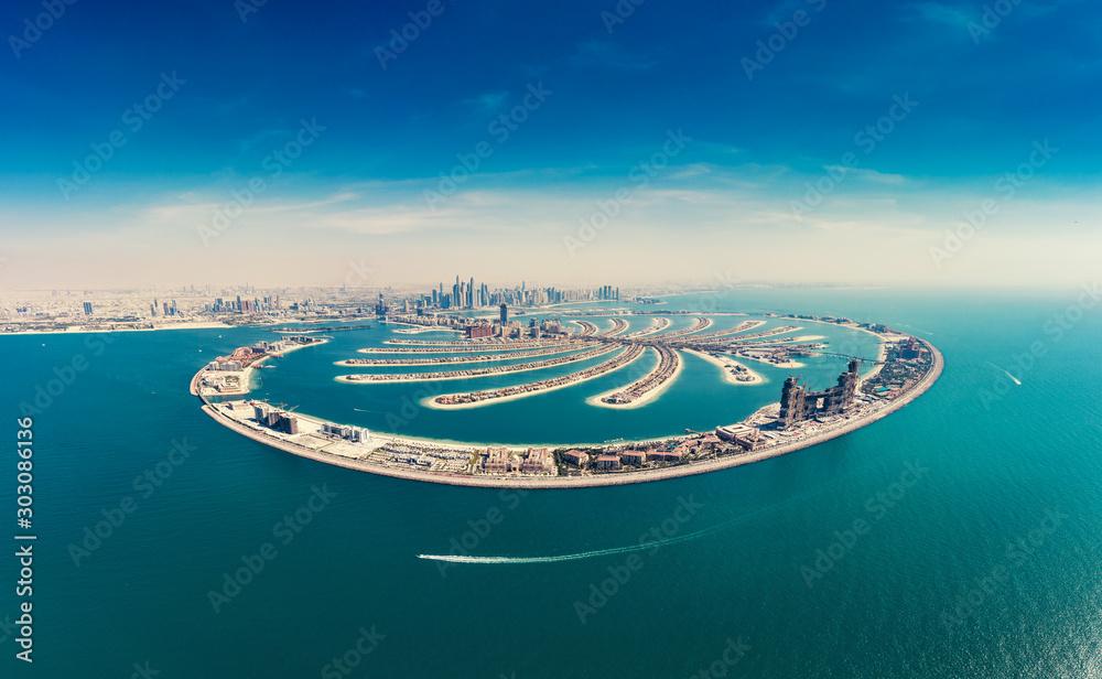 Fototapeta Aerial view on Palm Jumeira island in Dubai, UAE, on a summer day.