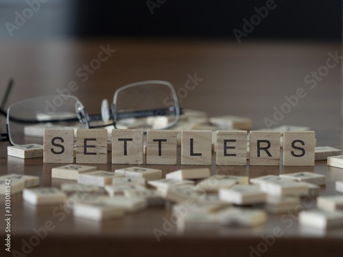 Cuadros en Lienzo  Settlers the word or concept represented by wooden letter tiles