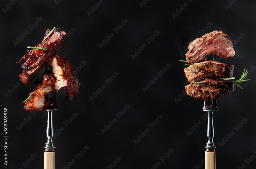 Fototapeta Grilled pork belly and beef steak with rosemary on a black background.