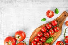 Fresh Tomatoes And Basil On Cu...