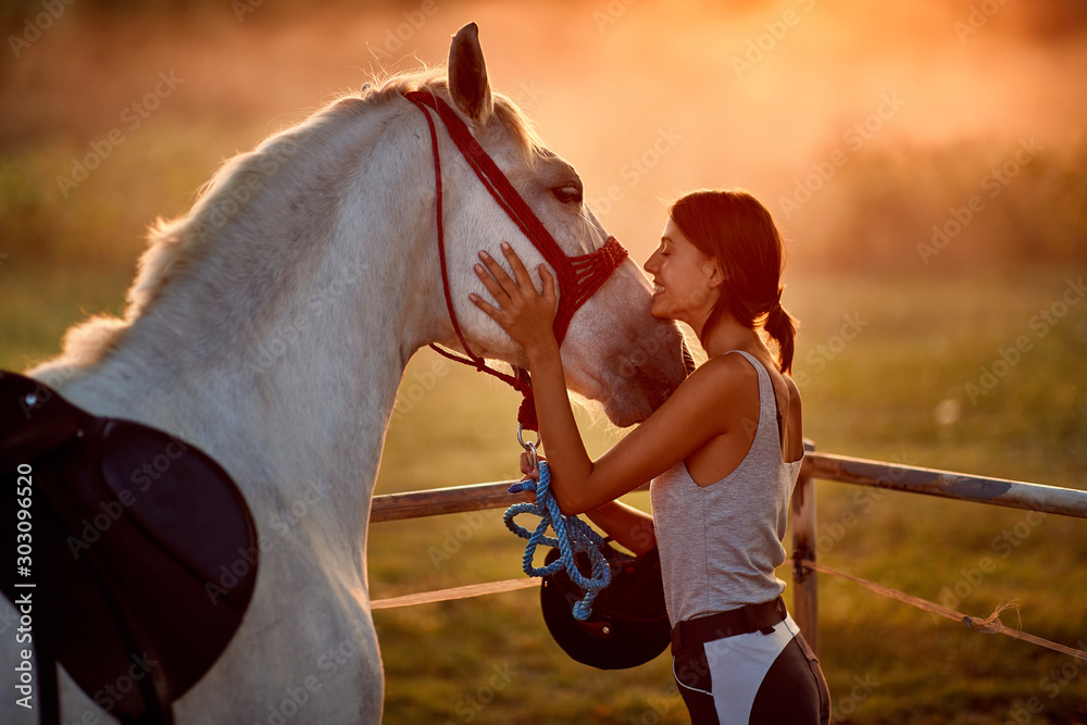 Fototapeta Natural bond between young woman and her horse