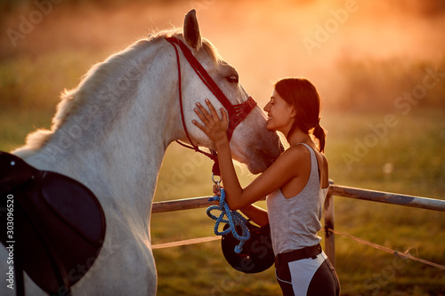 fototapeta na drzwi i meble Natural bond between young woman and her horse