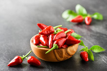 Hot Pepper In Wooden Bowl On D...