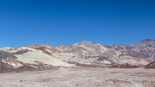 Interesting Rock Formations On Artist's Drive In Death Valley National Park In California. Clear Blue Sky Background