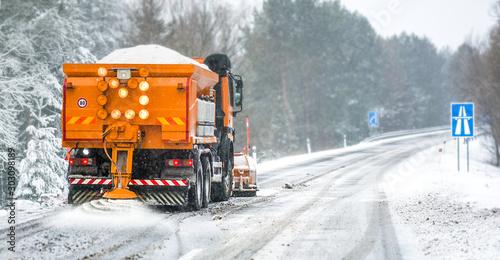 Snow plow on highway salting road Wallpaper Mural
