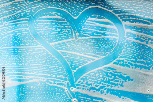 Valokuvatapetti Heart Shape On Abstract Soap Suds Over Window