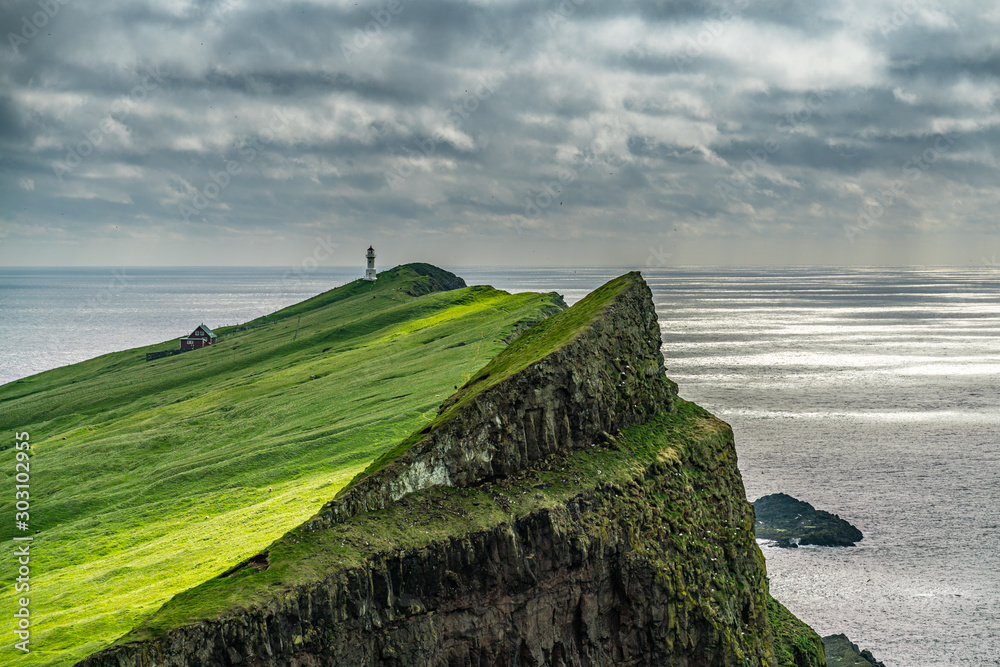 Fototapety, obrazy: The lighthouse on Mykines island under the clouds, Faroe Islands